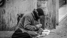 1595494816_grayscale-photography-of-man-praying-on-sidewalk-with-food-1058068.jpg
